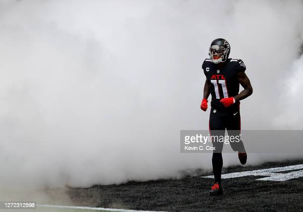Julio Jones of the Atlanta Falcons runs out on the field during player introductions prior to facing the Seattle Seahawks at MercedesBenz Stadium on...