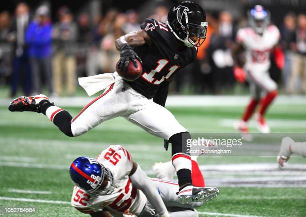 Julio Jones of the Atlanta Falcons runs with a second quarter catch against Alec Ogletree of the New York Giants at MercedesBenz Stadium on October...