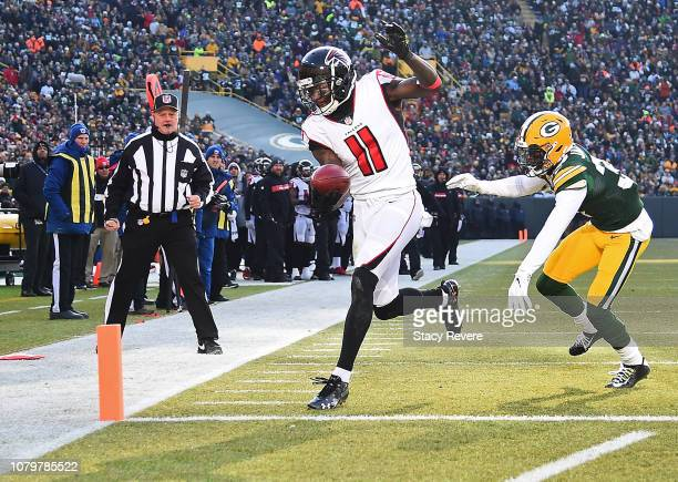 Julio Jones of the Atlanta Falcons scores a touchdown in front of Josh Jackson of the Green Bay Packers during the first half of a game at Lambeau...