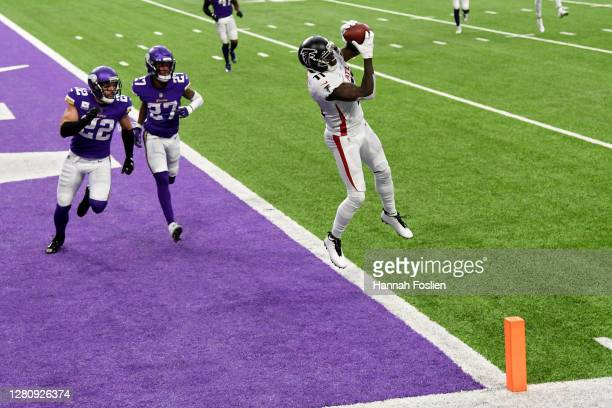 Julio Jones of the Atlanta Falcons scores a touchdown past Harrison Smith and Cameron Dantzler of the Minnesota Vikings at US Bank Stadium on October...