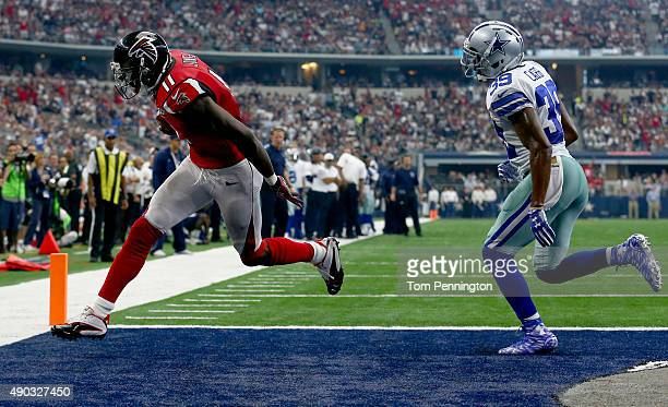 Julio Jones of the Atlanta Falcons takes a touchdown pass into the end zone to score as Brandon Carr of the Dallas Cowboys defends in the fourth...