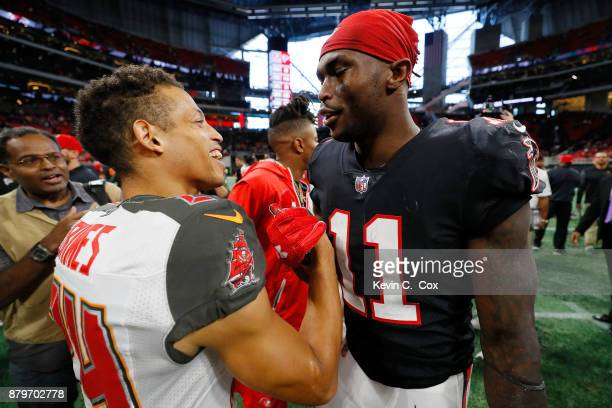 Julio Jones of the Atlanta Falcons talks to Brent Grimes of the Tampa Bay Buccaneers after the game at MercedesBenz Stadium on November 26 2017 in...