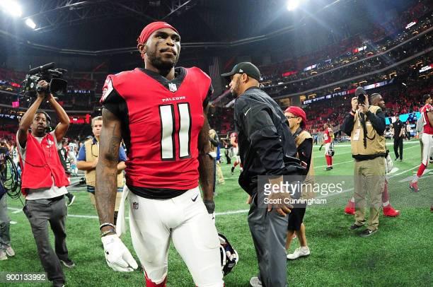 Julio Jones of the Atlanta Falcons walks off the field after beating the Carolina Panthers at MercedesBenz Stadium on December 31 2017 in Atlanta...