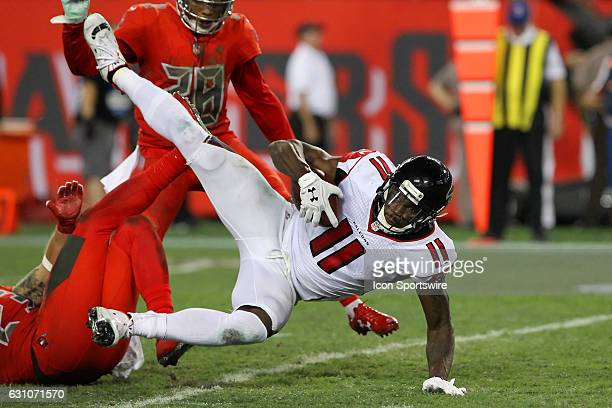 Julio Jones of the Falcons is brought down by the Bucs defense during the NFL game between the NFC South opponent Atlanta Falcons and Tampa Bay...