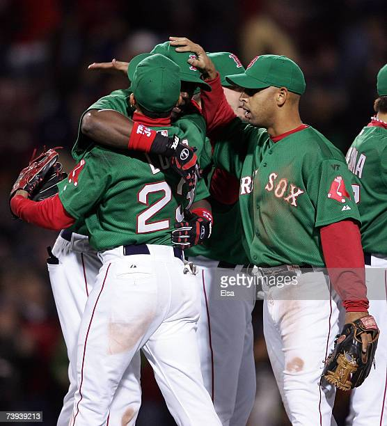 Julio Lugo of the Boston Red Sox is hugged by David Ortiz and Alex Cora after the game against the New York Yankees on April 20 2007 at Fenway Park...