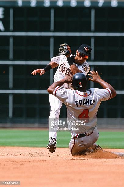 Julio Lugo of the Houston Astros attempts to tag out Julio Franco of the Atlanta Braves during Game One of the National League Division Series on...