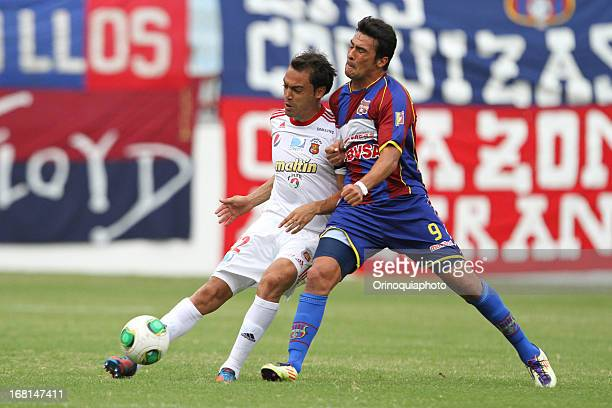 Julio Manchado of Caracas FC fights for the ball with Bryan Aldeve of Monagas during a match between Monagas and Caracas as part of the Torneo...
