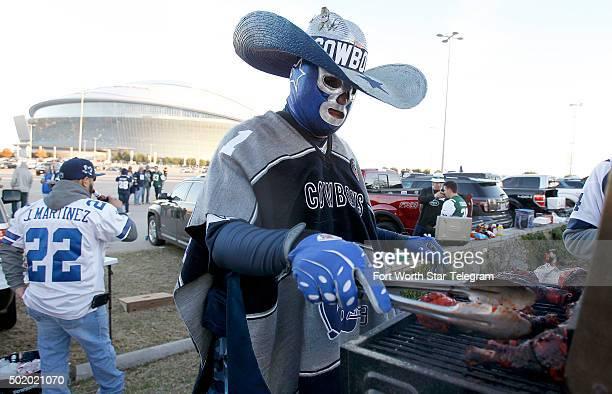 Julio Marin of Dallas tailgates before the Dallas Cowboys play host to the New York Jets at ATT Stadium in Arlington Texas on Saturday Dec 19 2015