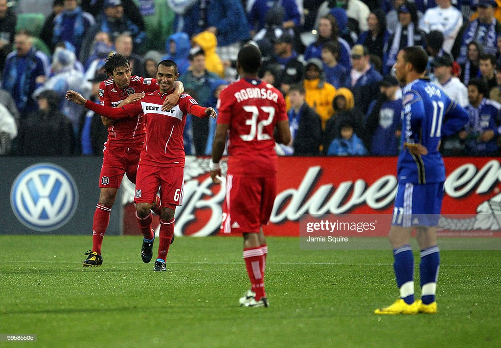 Julio Martinez #6 of the Chicago Fire is congratulated by Baggio Husidic #9 after scoring during the game against the Kansas City Wizards on May 15, 2010 at Community America Park in Kansas City, Kansas.
