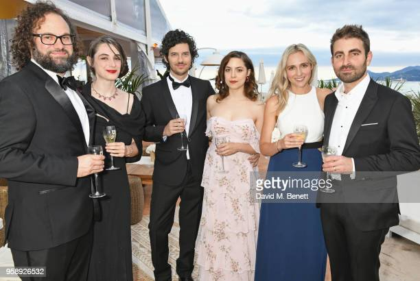 Julio Perez Anna McMillan Rich Vreeland Elizabeth Moroni guest and Mike Gioulakis pose at Nikki Beach for the Under The Silver Lake dinner presented...