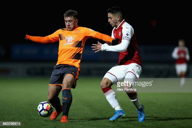 Julio Pleguezuelo of Arsenal closes down Danny Loader of Reading during the Premier League International Cup match between Arsenal and Reading at...