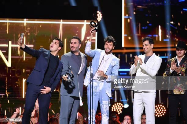 Julio Ramírez Eguía, Jesús Alberto Navarro Rosas, Sebastian Yatra and Gilberto Marín Espinoza accept an award on stage during Univision's Premio Lo...
