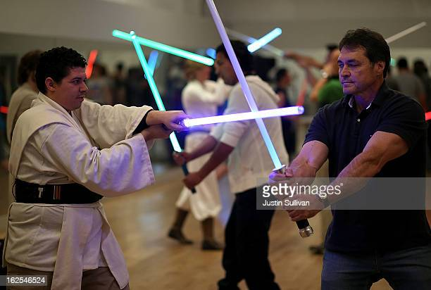Julio Reyes and Ron Nixon practice combat moves with lightsabers during a Golden Gate Knights class in saber choreography on February 24 2013 in San...