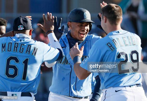 Julio Rodríguez of the Seattle Mariners reacts after hitting a walk-off single in the ninth inning to defeat the San Diego Padres 5-4 during the MLB...