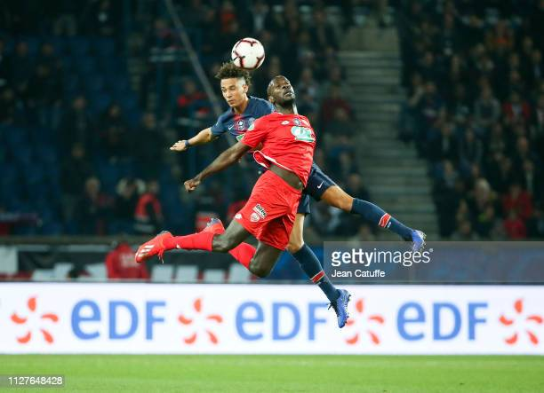 Julio Tavares of Dijon Thilo Kehrer of PSG during the French Cup quarterfinal match between Paris SaintGermain and Dijon Football Coted'Or at Parc...