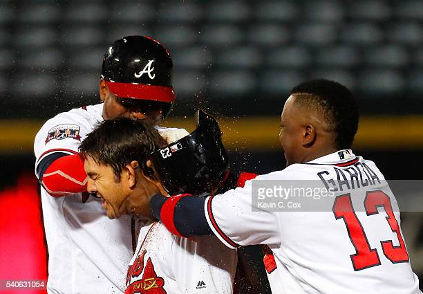 Julio Teheran and Adonis Garcia of the Atlanta Braves toss dirt on Chase d'Arnaud after he hit a walkoff single to give the Braves a 98 win over over...