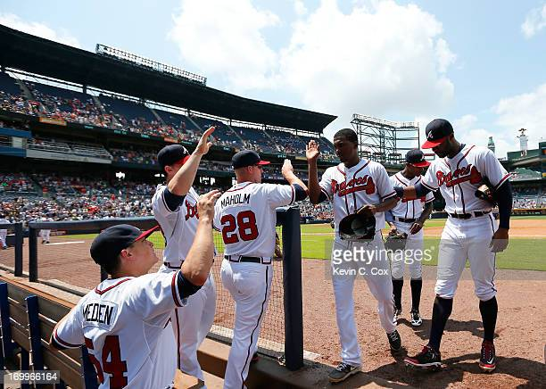 Julio Teheran of the Atlanta Braves celebrates with teammates after the eighth inning against the Pittsburgh Pirates at Turner Field on June 5 2013...