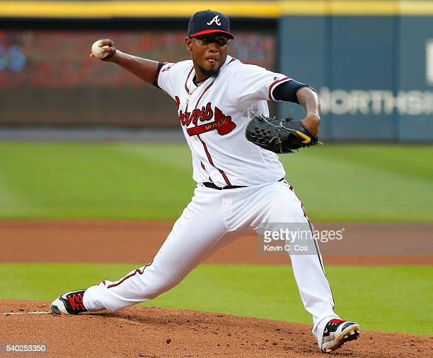 Julio Teheran of the Atlanta Braves pitches in the first inning against the Cincinnati Reds at Turner Field on June 14 2016 in Atlanta Georgia