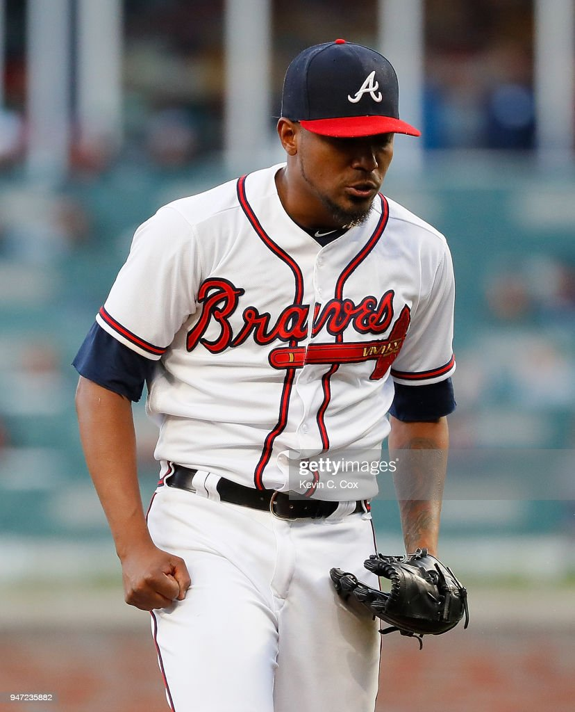 Julio Teheran #49 of the Atlanta Braves reacts after giving up a solo homer to Odubel Herrera #37 of the Philadelphia Phillies in the first inning at SunTrust Park on April 16, 2018 in Atlanta, Georgia.