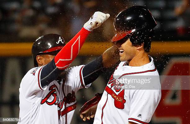 Julio Teheran of the Atlanta Braves tosses dirt on Chase d'Arnaud after he hit a walkoff single to give the Braves a 98 win over over the Cincinnati...