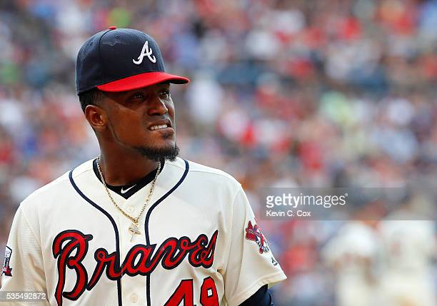 Julio Teheran of the Atlanta Braves walks off the field after being pulled from giving up a tworun homer to Derek Dietrich of the Miami Marlins in...