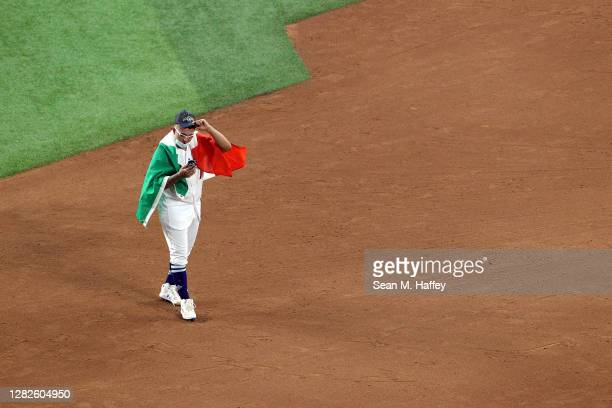 Julio Urías of the Los Angeles Dodgers celebrates on the field after defeating the Tampa Bay Rays 31 in Game Six to win the 2020 MLB World Series at...
