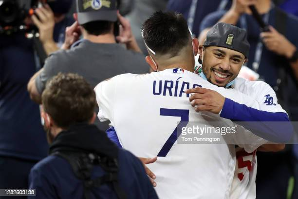 Julio Urias and Mookie Betts of the Los Angeles Dodgers celebrate after defeating the Tampa Bay Rays 3-1 in Game Six to win the 2020 MLB World Series...