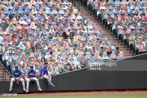 Julio Urias, Dennis Santana and Victor Gonzalez of the Los Angeles Dodgers look on before their game against the Seattle Mariners at T-Mobile Park on...