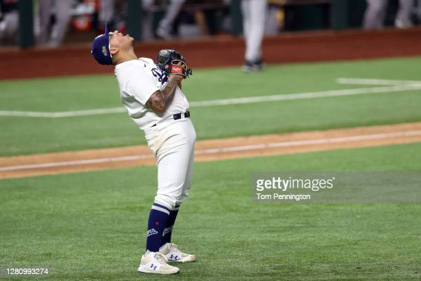 Julio Urias of the Los Angeles Dodgers celebrates after closing out the teams 4-3 victory against the Atlanta Braves in Game Seven of the National...