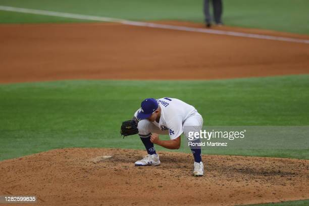 Julio Urias of the Los Angeles Dodgers celebrates after defeating the Tampa Bay Rays 3-1 in Game Six to win the 2020 MLB World Series at Globe Life...