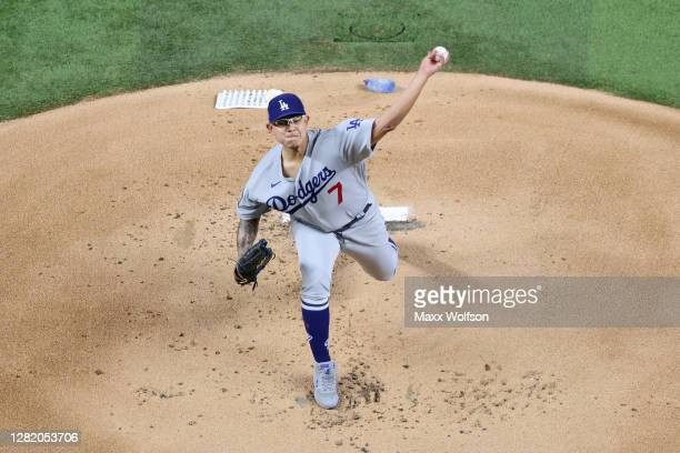 Julio Urias of the Los Angeles Dodgers delivers the pitch against the Tampa Bay Rays during the first inning in Game Four of the 2020 MLB World...