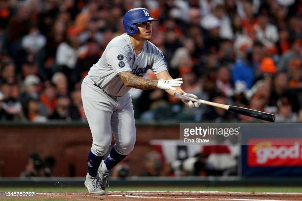 Julio Urias of the Los Angeles Dodgers hits an RBI single in the second inning against the San Francisco Giants during Game 2 of the National League...