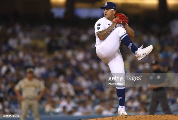 Julio Urias of the Los Angeles Dodgers pitches against the San Diego Padres during the seventh inning at Dodger Stadium on September 10, 2021 in Los...
