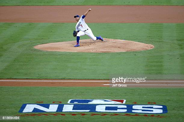Julio Urias of the Los Angeles Dodgers pitches in the first inning against the Chicago Cubs in game four of the National League Championship Series...