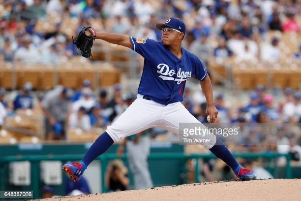Julio Urias of the Los Angeles Dodgers pitches in the first inning against the Seattle Mariners during the spring training game at Camelback Ranch on...