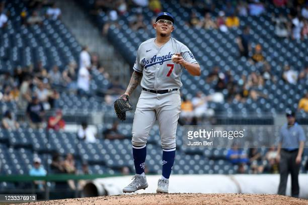 Julio Urias of the Los Angeles Dodgers reacts after giving up a two run home run to Bryan Reynolds of the Pittsburgh Pirates in the third inning...