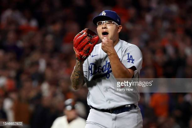 Julio Urias of the Los Angeles Dodgers reacts after the third out of the fourth inning against Wilmer Flores of the San Francisco Giants in game 5 of...