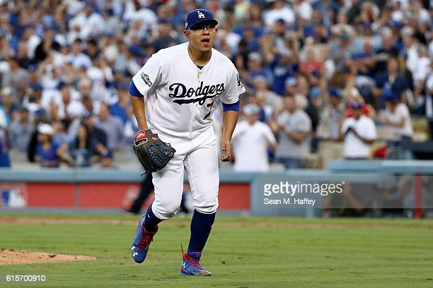 Julio Urias of the Los Angeles Dodgers reacts at the end of the second inning against the Chicago Cubs in game four of the National League...