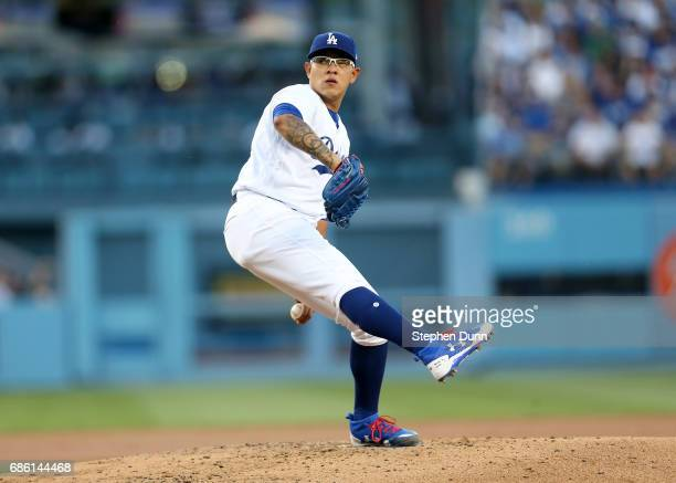 Julio Urias of the Los Angeles Dodgers throws pitch in the second inning against the Miami Marlins at Dodger Stadium on May 20 2017 in Los Angeles...