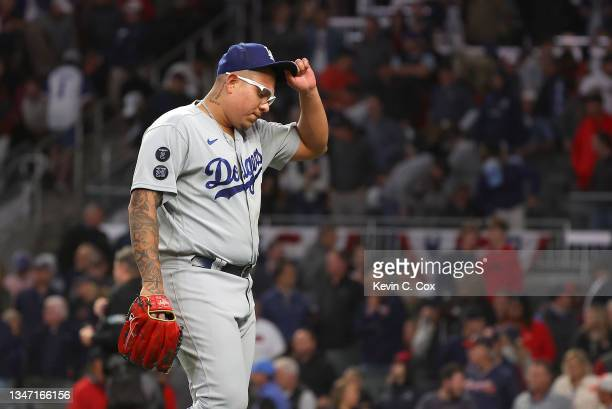 Julio Urias of the Los Angeles Dodgers walks off the field after the end of the eighth inning of Game Two of the National League Championship Series...