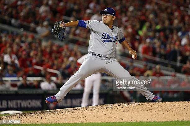 Julio Urias of the Los Angeles Dodgers works against the Washington Nationals in the fifth inning during game five of the National League Division...