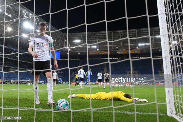Julio Villalba and Tobias Sippel of Borussia Moenchengladbach look dejected after conceding their side's third goal scored by Andrej Kramaric of TSG...