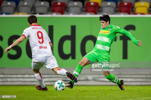 Julio Villalba of Borussia Moenchengladbach and Benito Raman of Fortuna Duesseldorf battle for the ball during the friendly match between Fortuna...