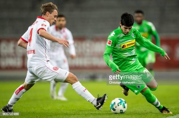Julio Villalba of Borussia Moenchengladbach is chased by Julian Schauerte of Fortuna Duesseldorf during the friendly match between Fortuna...