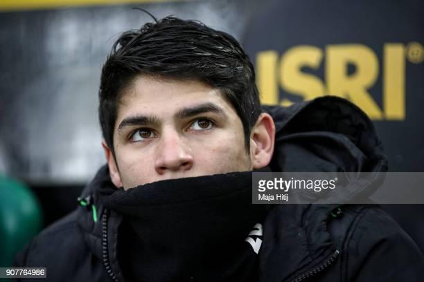 Julio Villalba of Moenchengladbach sits on the bank during the Bundesliga match between Borussia Moenchengladbach and FC Augsburg at BorussiaPark on...