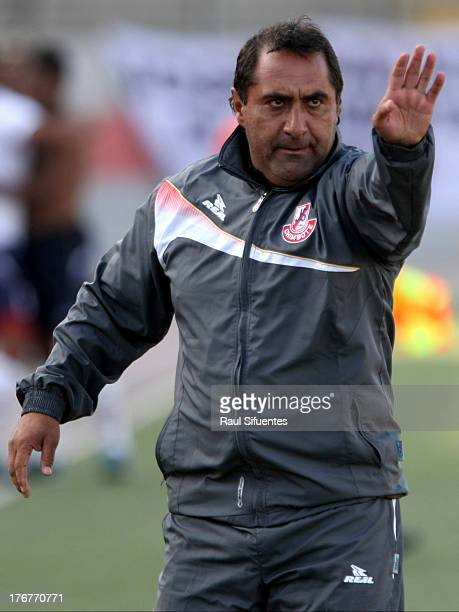 Julio Zamora head coach of Jose Galvez gestures during a match between Jose Galvez and Sporting Cristal as part of The Torneo Descentralizado 2013 at...