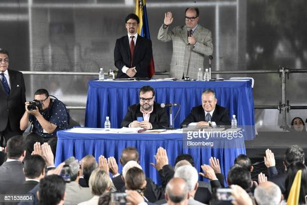 Julio Borges president of the National Assembly top right speaks while Freddy Guevara vice president of the National Assembly top left stands during...