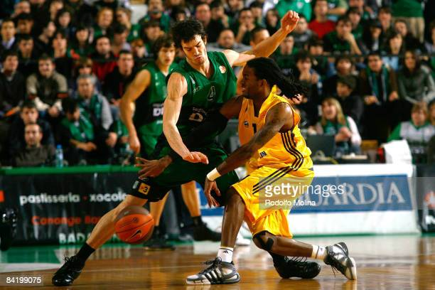 Julios Jenkins #11 of Alba Berlin competes with Pau Ribas #4 of DKV Joventut during the Euroleague Basketball Game 9 match between DKV Joventut and...