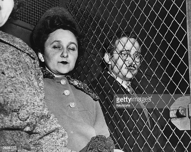 Julius and Ethel Rosenberg in a Marshal's van en route to the Federal House of Detention after they had been found guilty of nuclear espionage They...