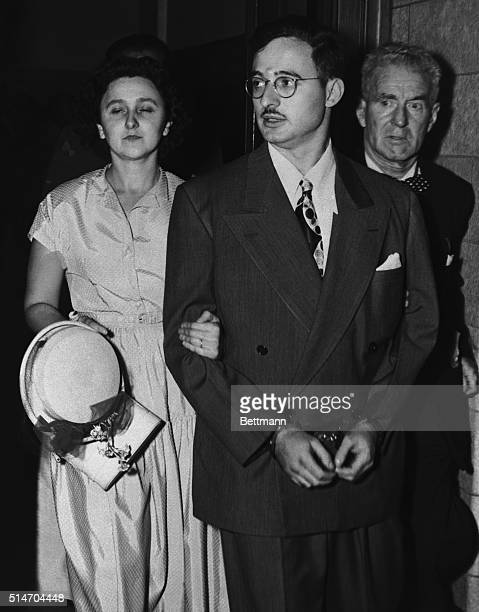 Julius and Ethel Rosenberg leave federal court after being indicted on charges of espionage in the Klaus Fuchs atomic spy ring